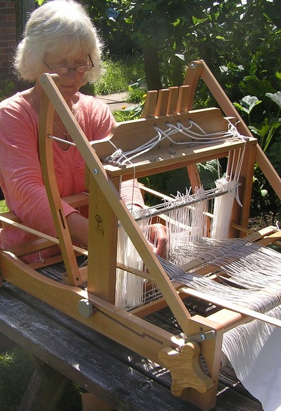 Fiona threading up an Ashford table loom